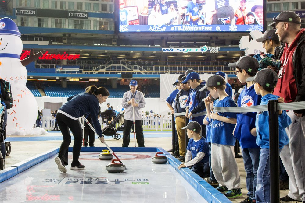 Synthetic curling rinks for fans